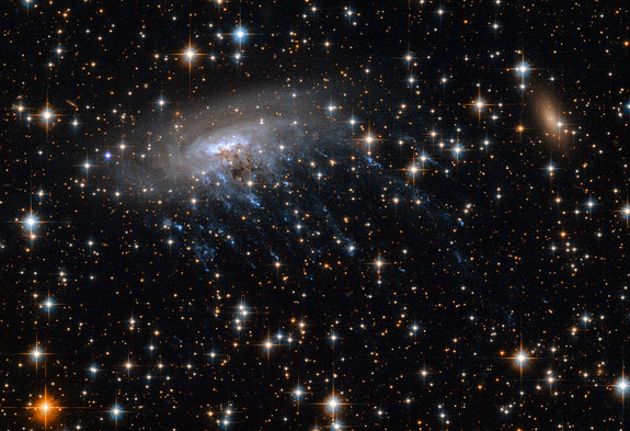 This Hubble Telescope image shows spiral galaxy ESO 137-001.